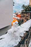 Snowman from the snow on the street Royalty Free Stock Photography