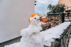 Snowman from the snow on the street Stock Photography