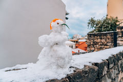 Snowman from the snow on the street Royalty Free Stock Photo