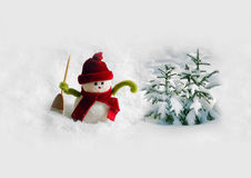 Snowman in snow Royalty Free Stock Image
