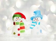 Snowman on snow on white. Snowman on snow. Studio shot Royalty Free Stock Images