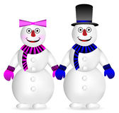 Snowman and snow woman Royalty Free Stock Photography