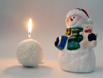 Snowman and snowball candle. For christmas royalty free stock image
