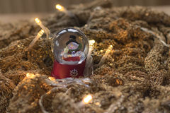 Snowman in snowball with lights on golden rune Royalty Free Stock Photo
