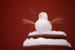 snowman snowbird. A snowbird putting on the top of a old Chinese red wood lantern, typical Chinese red wall as background Royalty Free Stock Photography