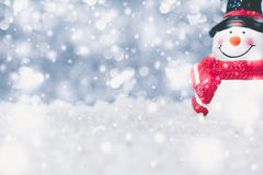 Snowman on snowfall Stock Photography