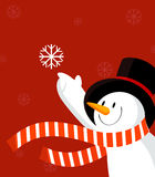 Snowman with snowflake. Red. Stock Photos