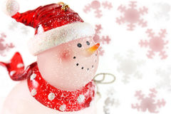 Snowman on a snowflakes. Snowman on a snowflake and white background royalty free stock photo