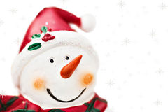 Snowman with snowflakes isolated on white Royalty Free Stock Photo