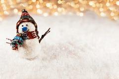 Snowman On Snowy Background Stock Photos