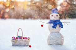 Snowman on a snowy winter background Stock Photo