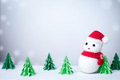 Snowman in snowy winter background with paper cut christmas tree royalty free stock image