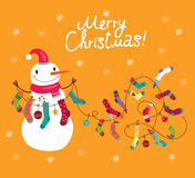 Snowman with socks and gifts Cute snowman, christmas card. Royalty Free Stock Image