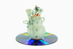 Snowman songs CD. Snowman ornament sitting on the CD of winter songs Royalty Free Stock Photo