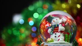 Snowman Sphere on Bokeh Background stock video footage