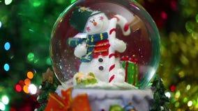 Snowman Sphere on Bokeh Background stock footage