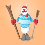 Snowman. Sportsman Snowman with skis and ski poles in his hands dressed in blue sweater Stock Image