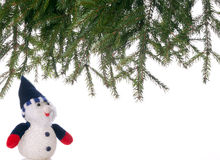 Snowman and spruce branches. Royalty Free Stock Photography