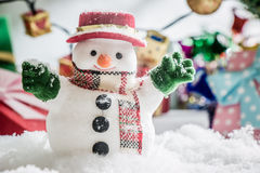 Snowman stand among pile of snow at silent night with a light bulb, light up the hopefulness and happiness in Merry christmas and Stock Photo