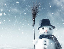 Snowman standing in christmas landscape. Happy snowman standing in winter christmas landscape Stock Image