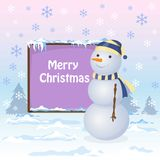 Snowman is standing near the board. Snowflakes are falling. Winter landscape. Snowdrift. Place for the text Stock Photography