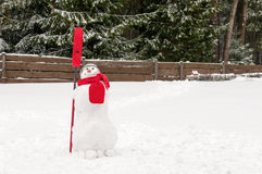 Snowman. Standing in winter landscape Royalty Free Stock Image