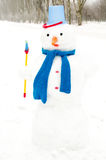 Snowman standing in winter landscape Royalty Free Stock Photos