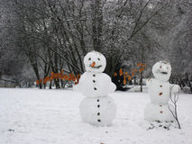 Snowman standing in winter landscape Stock Image