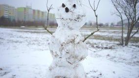 Snowman standing on a snowy field