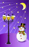 Snowman stands under a street lamp on christmas evening  illustration Royalty Free Stock Image