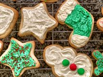 Snowman, star, and stocking iced Christmas cookies