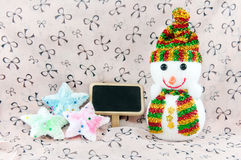 Snowman and stars Stock Images