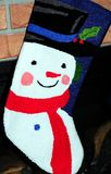 Snowman stocking on fireplace Royalty Free Stock Image