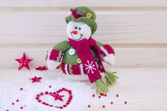 Snowman surounded by stars and hearts Royalty Free Stock Photos