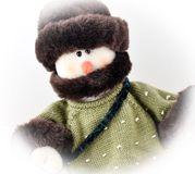 Snowman in Sweater and Hat. Stuffed snowman wearing a sweater and hat Stock Photos