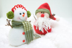 Snowman Tale. Snowman and Santa showing their friendship for everyone Royalty Free Stock Photo
