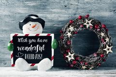 Snowman and text wish you have wonderful holidays stock image