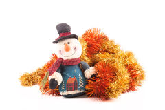 Snowman and tinsel on a white background Royalty Free Stock Images