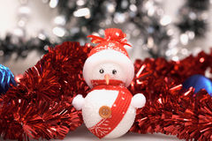 Snowman and tinsel Royalty Free Stock Images