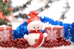 Snowman and tinsel Stock Photos