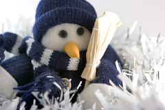 Snowman in tinsels Stock Photo
