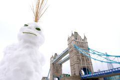 Snowman and Tower Bridge, London, UK Royalty Free Stock Images