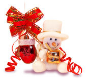 Snowman with a toy Stock Images