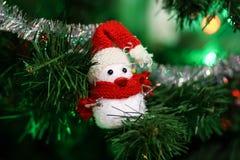 Snowman toy on Christmas tree Royalty Free Stock Photos