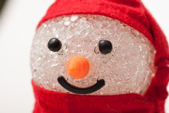 Snowman toy. Crystal snowman toy face decorated with red scarf and hat Stock Images