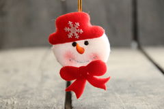 Snowman toy on rustic wooden table. Winter idea. Royalty Free Stock Image