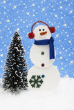 Snowman with Tree Stock Photography