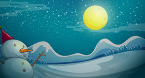 A snowman under the bright moon Royalty Free Stock Photography