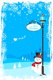 Snowman under lamp post Stock Photo