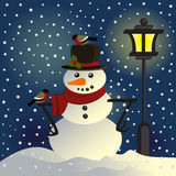 Snowman under lantern Royalty Free Stock Photography
